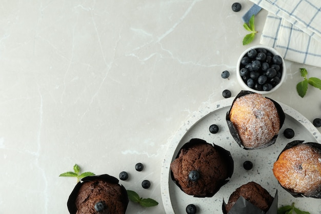 Concept of delicious food with chocolate muffins on light background.