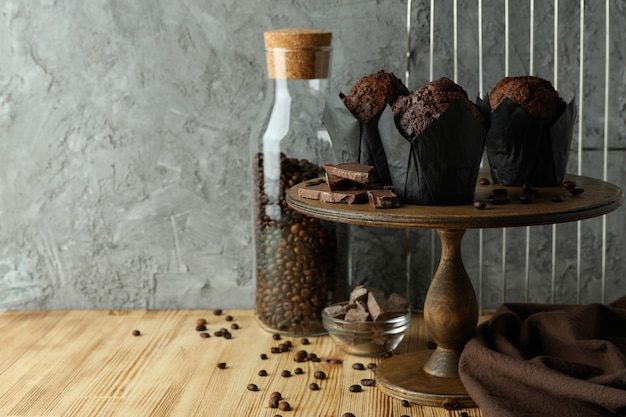 Concept of delicious food with chocolate muffins, space for text.