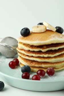 Concept of delicious food with pancakes, close up