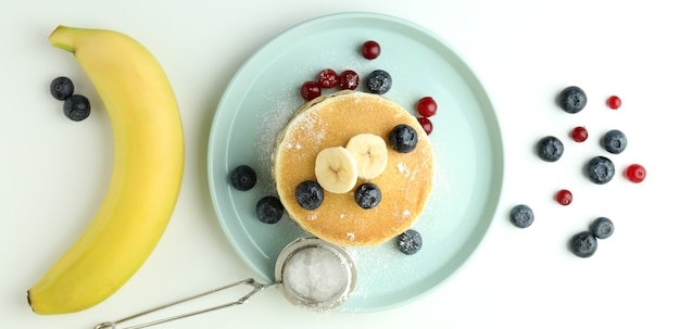 Concept of delicious food with pancakes on white table