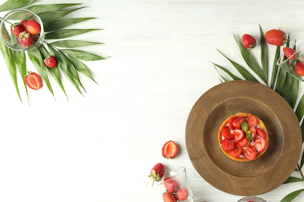 Concept of delicious food with strawberry tart, space for text.