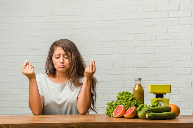Concept of diet. portrait of a healthy young latin woman sad and depressed
