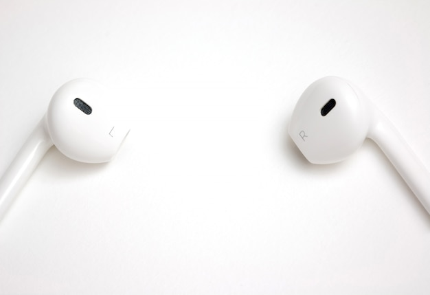 Concept of digital music white headphones with copy space for insert wording or image