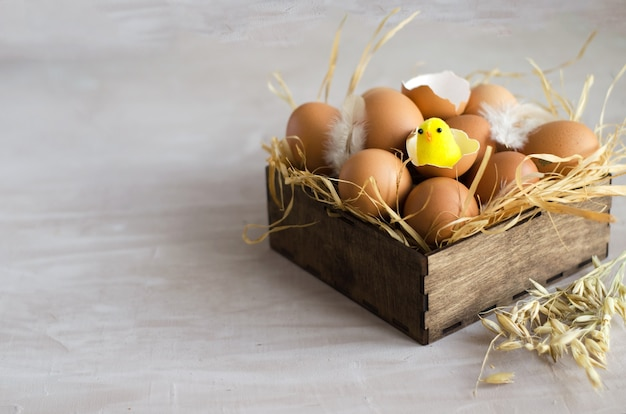 The concept of easter. natural brown chicken eggs lie in a wooden box