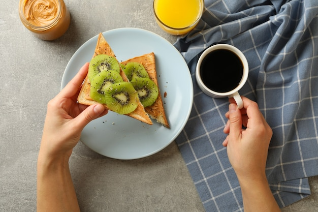 Concept of eating toast with kiwi