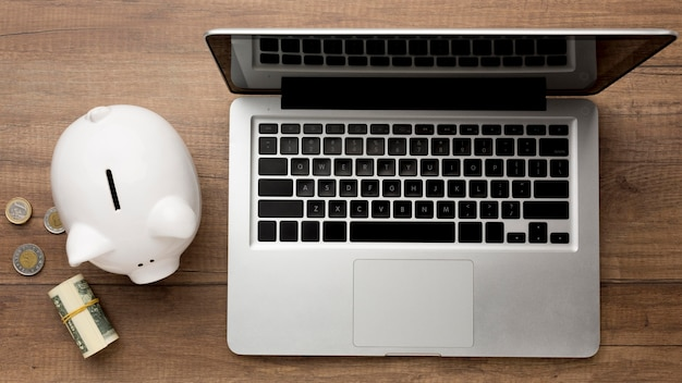 Concept of economy with piggy bank and laptop