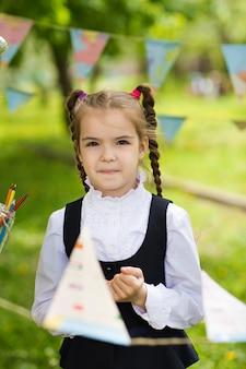 Concept - education. back to school. portrait of a beautiful caucasian schoolgirl girl