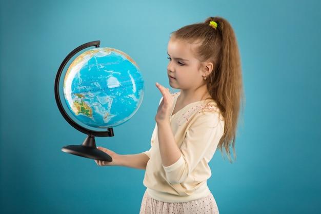 Concept - education. caucasian girl holding a globe
