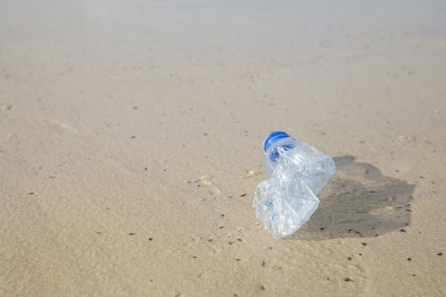 Concept for environmental campaign.plastic bottle at the beach.