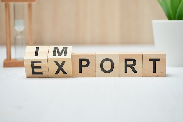 The concept of export and import on wooden cubes.