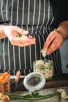 Concept of fermented meal. canned food. vegan food. vegetables.