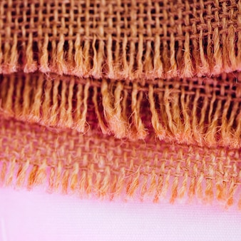 Concept of fibers of burlap material in pinkness