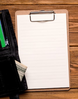 The concept of financing and credit. a blank sheet of paper next to the wallet.
