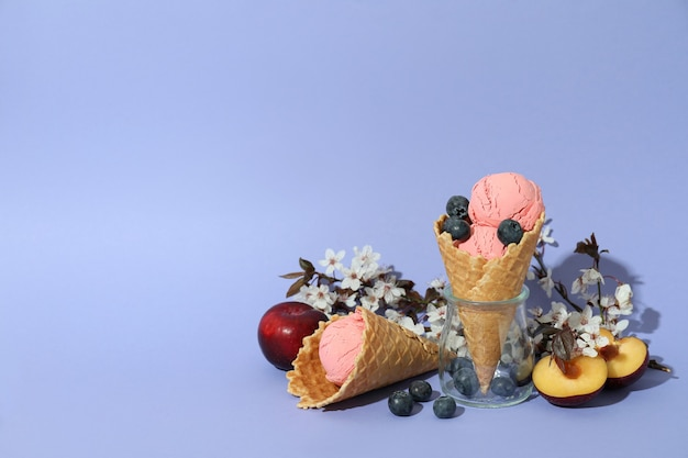 Concept of fruit ice cream on violet background