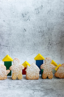 Concept of gingerbread and cubes in support of the stay at home promotion. selective focus.