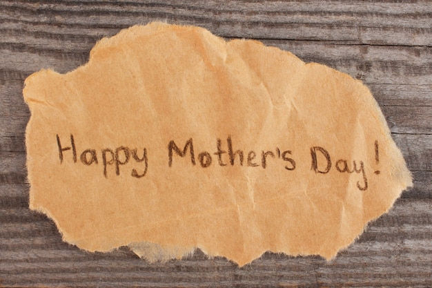 Concept of greeting happy mother's day on old wooden background.