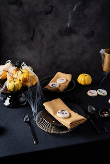 Concept of halloween party with handmade cooke on the dark tavle
