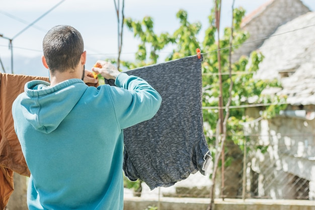 Concept of hanging clothes to dry in garden