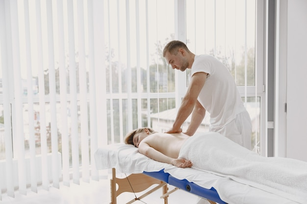 Concept of healthcare and female beauty. masseuses make a massage of a girl. woman in a spa salon.