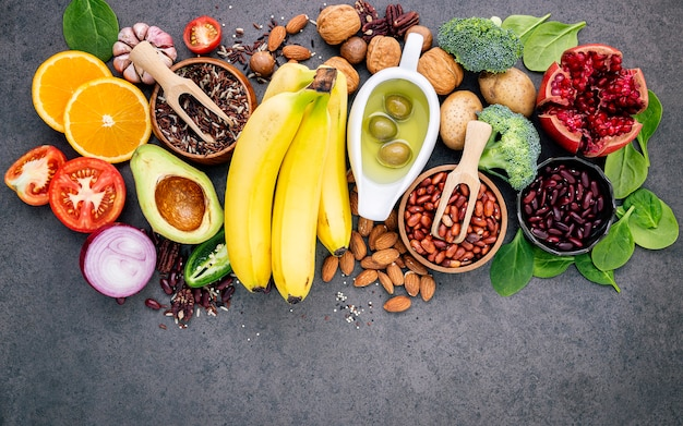 The concept of healthy food set up on dark concrete background copy space.