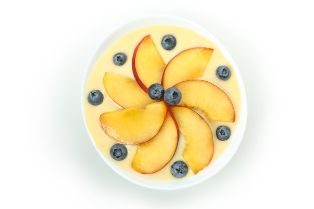 Concept of healthy food with peach yogurt isolated on white background