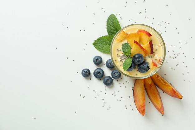 Concept of healthy food with peach yogurt on white background