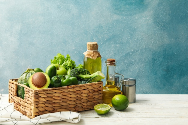 Concept of healthy food with vegetables and fruits on white wooden table