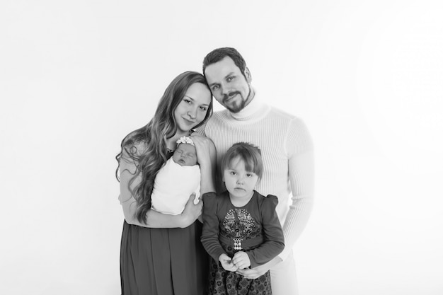 Concept of healthy lifestyle, protection of children, shopping - baby in the arms of the mother and father. woman and man holding a child. copy space. portrait of faamily
