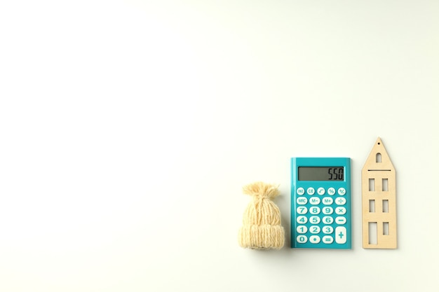 Concept of heating season with calculator on white background.