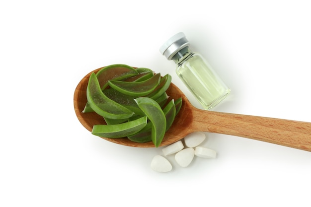 Concept of herb pills with aloe isolated on white background