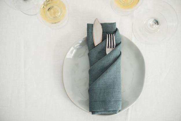 Concept of home decor with green linen napkins, selective focus