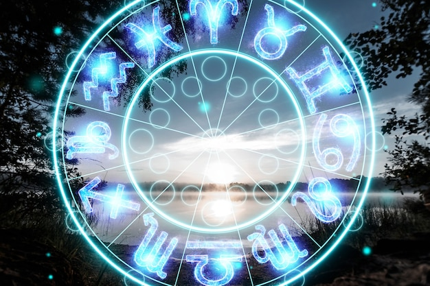 The concept of the horoscope, circle with the signs of the zodiac on a background of dawn, astrology. consulting with the stars.