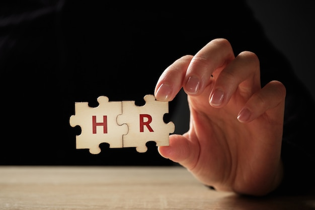 The concept of a human resource on a puzzle in hands.