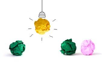Concept idea  multicolor crumpled Paper Light Bulb on white backgournd