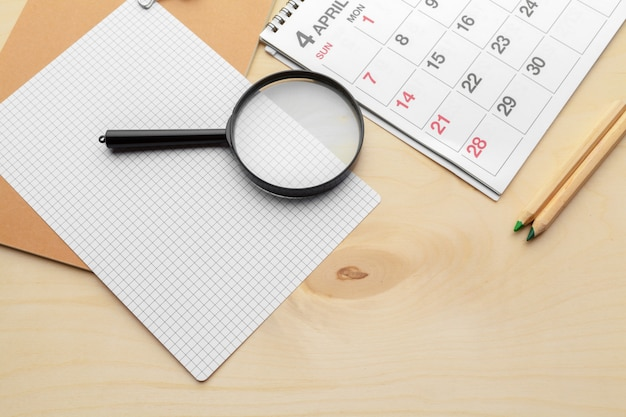 Concept image of business and meetings. calendar to remind you an important appointment and magnifying glass