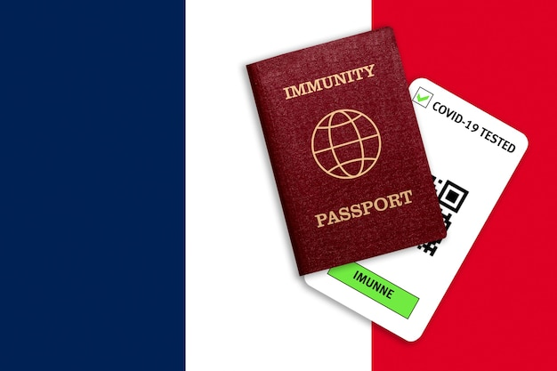 Concept of immunity to coronavirus. immunity passport and test result for covid-19 on flag of france