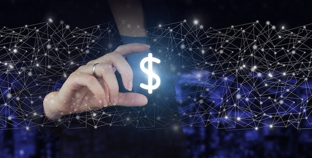 Concept of insurance or bank, currency growth. hand hold digital hologram dollar sign on city dark blurred background. experienced seller or bank or insurance broker