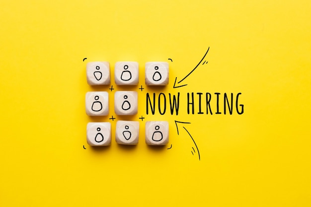 Concept is now hiring. abstract staff icons on dice.