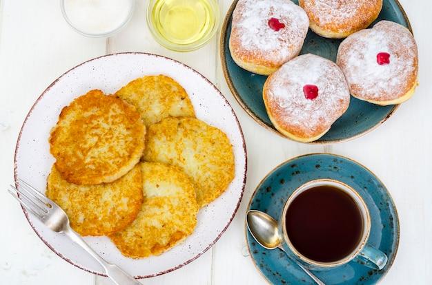 Concept jewish holiday hanukkah. traditional food doughnuts and potatoes pancakes latkes.