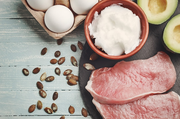 Concept of ketogenic diet, dietary food on light table