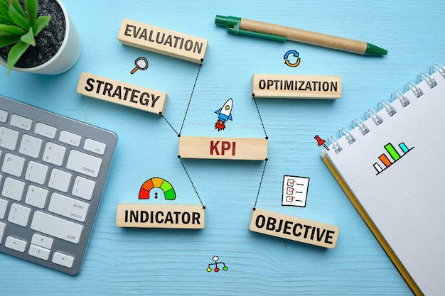 The concept of kpi and the main connections with it on wooden blocks.