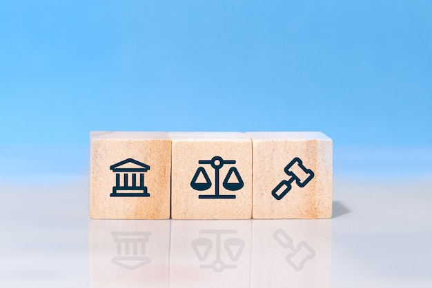 Concept of law and justice. wooden block cube shape with icon law legal justice