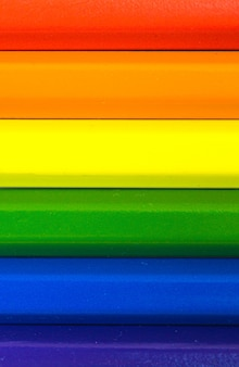 Concept of lgbt and lgbtq rainbow flag made with colored pencils, vertical photo
