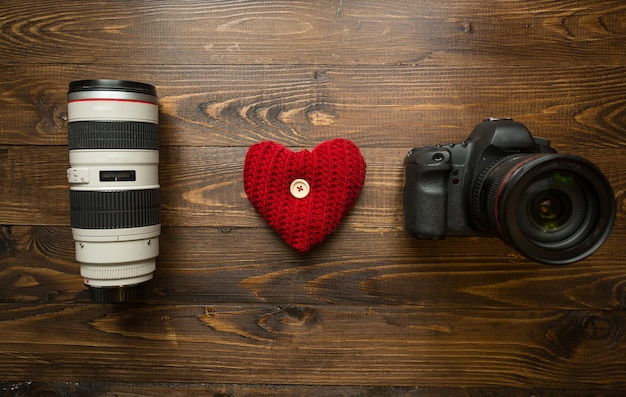 Concept of loving photography. i love photography phrase made of lens, digital camera and red heart.