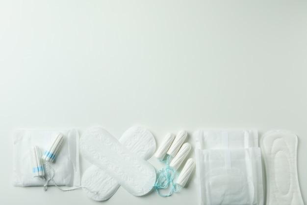 Concept of menstruation on white background