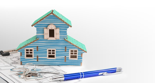 The concept of mortgage and rental housing and real estate. mortgage credit lending. house mock up with keys with blueprint on white isolated background.
