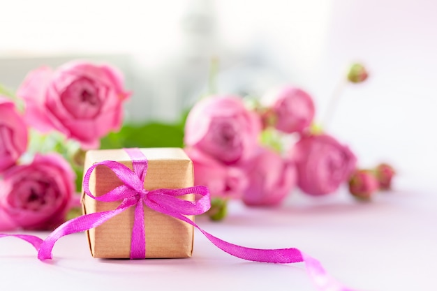 Concept mother's day. gift present box with beautiful pink flowers roses bouquet.