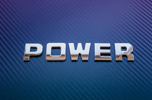 Concept of motor sport, speed, engine power. letters on carbon fiber surface