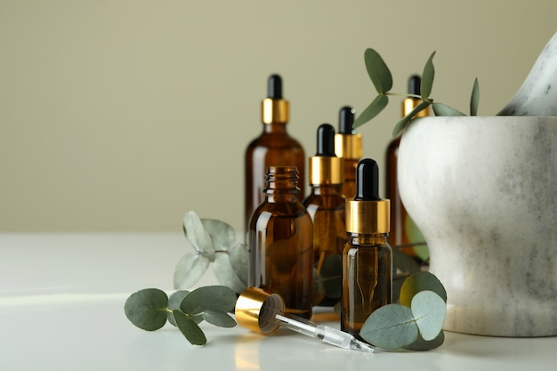 Concept of natural cosmetics with eucalyptus oil on white table
