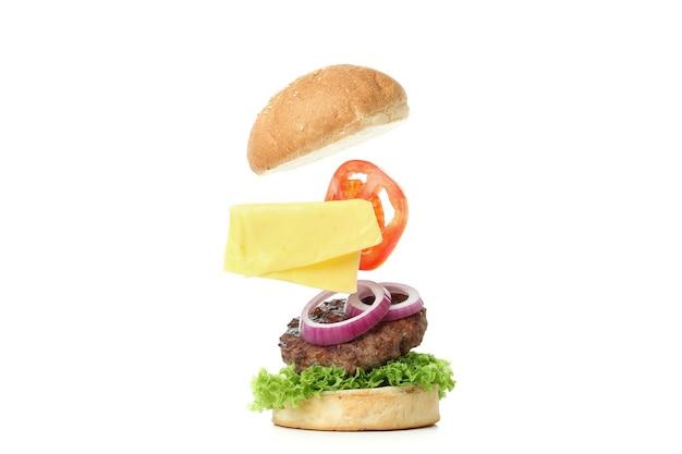 흰색 배경에 고립 된 요리 햄버거의 개념